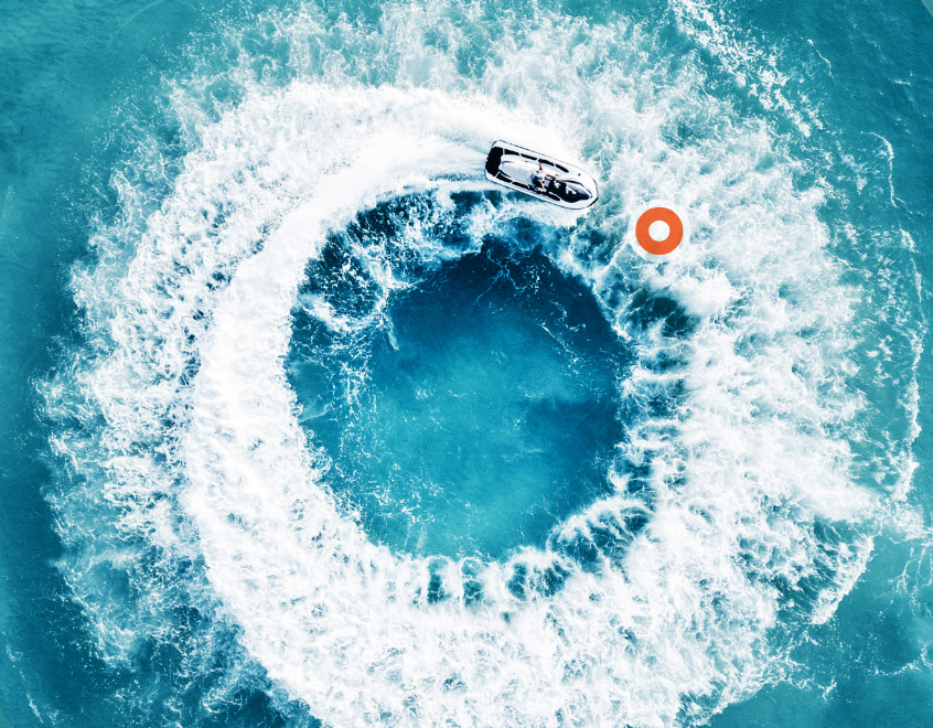 Aeriel Graphic of speedboat creating O graphic