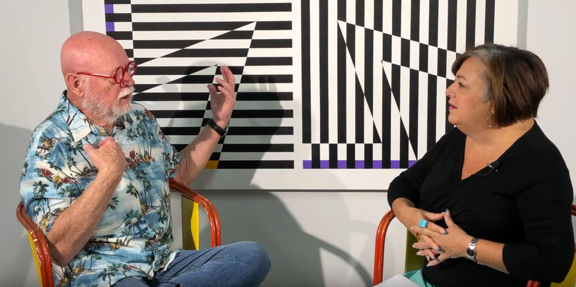 Gary Hinsche is interviewed at art exhibition
