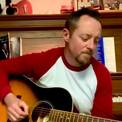 David Bowman playing guitar