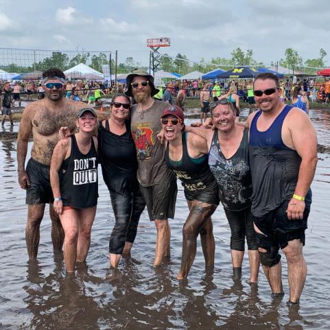 Ohlmann Group team members on mud volleyball team