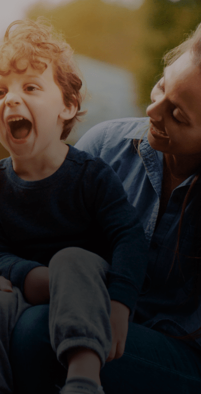 Woman and son smile in CareSource commercial