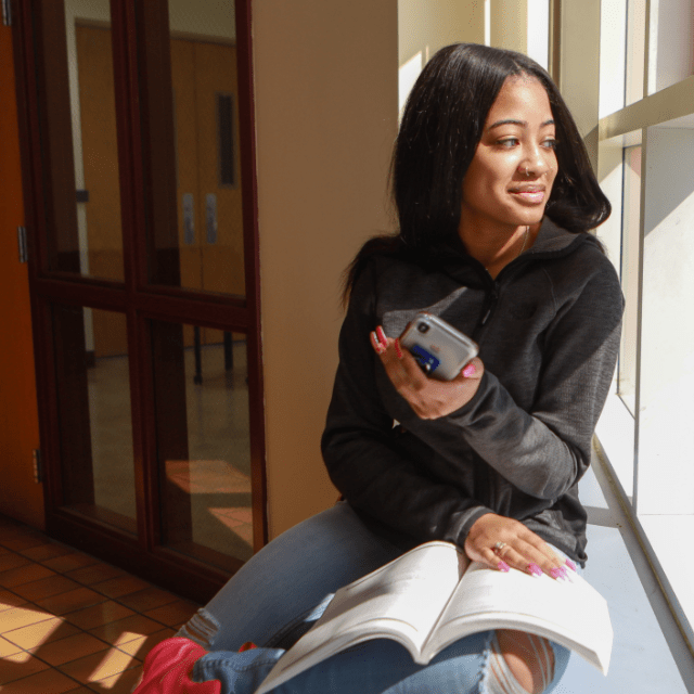 Central State student posing by window