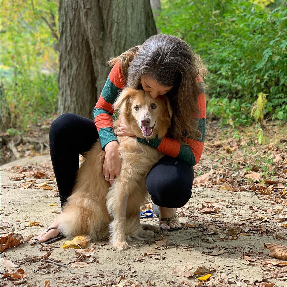 Ohlmann Group team member hugging dog